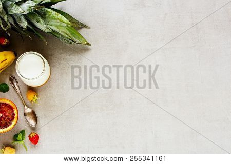 Delicious Breakfast Flat Lay. Fresh Fruit And Berries, Greek Yogurt On Light Table Background. Clean