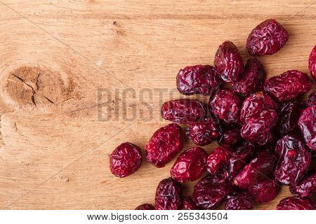 Healthy Food Organic Nutrition. Border Frame Of Dried Cranberries Cranberry Fruit On Wooden Backgrou