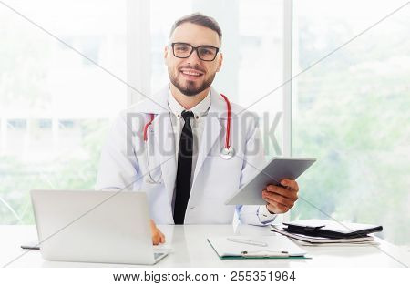 Male Doctor Working In Hospital. Healthcare And Medical Service.