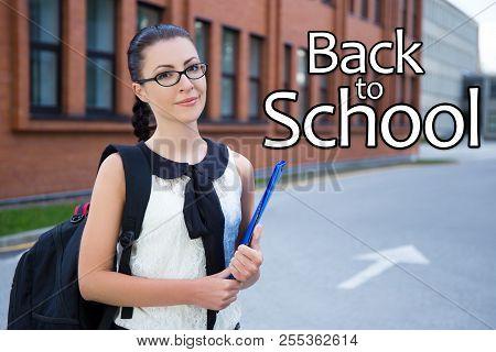 Back To School - Beautiful Girl In School Uniform Standing In Campus
