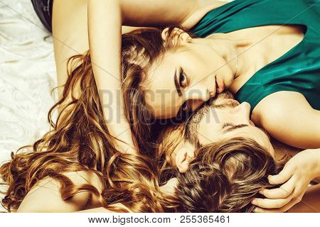 Sexy Couple Young Beautiful Cute Lovers In Love Pretty Girl And Sexi Man Lying On Back On White Beds