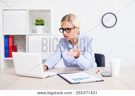 Stressed Business Woman Sitting In Office Having Problems With Her Computer