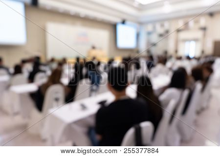 Blurred Background Of Business People Listening Speaker On Stage With Rear View Of Audience In Confe