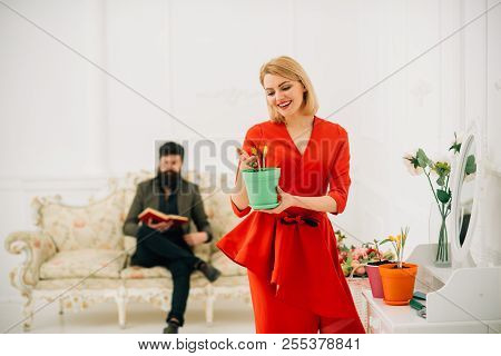 Growth Concept. Sensual Woman Care Of Spring Flower In Pot, Growth. Growth And Development. Growth S