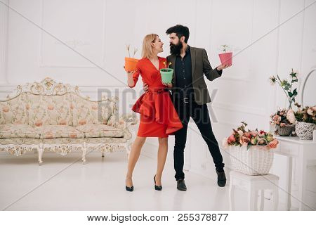 Flower Shop Concept. Sensual Woman And Bearded Man In Flower Shop. Couple In Love In Flower Shop. Sh