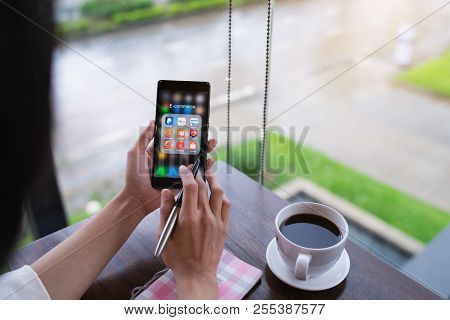 Chiang Mai, Thailand - August 18,2018: Woman Holding Huawei With Icons Of E-commerce And Online Shop