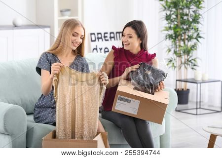 Young women unpacking parcels at home
