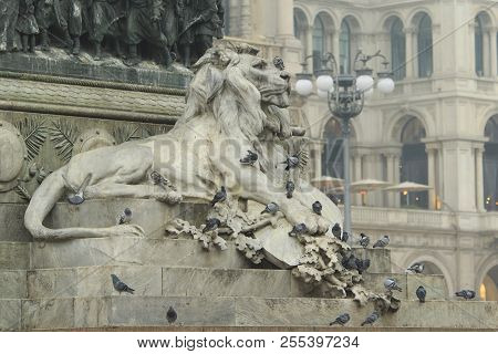 Lion Statuary With A Bunch Of Doves In Main Milan Square Piazza Del Duomo