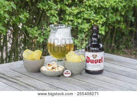 Sint Gillis Waas, Belgium - July 22, 2018: Belgian Beer Duvel With Feta Cheese And Salted Chips In S