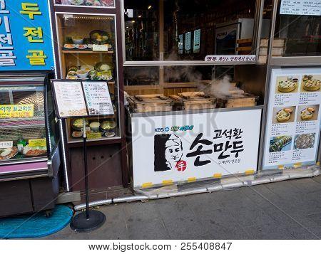 Seoul, South Korea - June 3, 2017: Cafe Specializing In Korean Food - Dumplings, Mandu On The Street