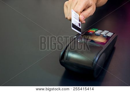 Female Hand With Credit Card And Bank Terminal, Card Machine Or Pos Terminal With Inserted Blank Whi