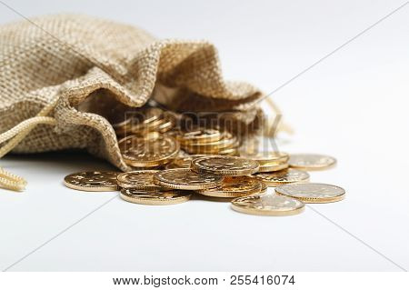 Image Of Golden Rmb Coins In Cloth Bag