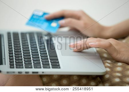 Close-up Of Beautiful Woman Hands Using Laptop And Holding Credit Card, Paying With Credit Card For