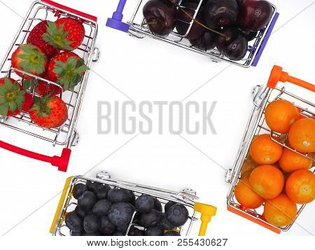 Fresh Summer Fruits, Cherry, Strawberry, Cape Gooseberry And Blueberry In Shopping Cart Or Trolly Is