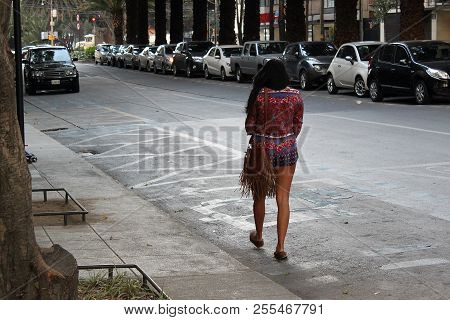 Lonely beautiful woman walking on the street of metropolis, latina woman in mexico city, city street with cars and lonely woman, Mexico city poster