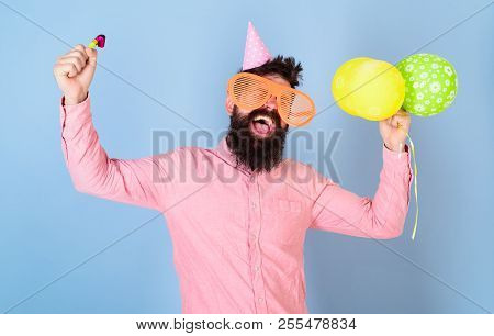 Man With Beard And Mustache On Happy Face Holds Air Balloons, Light Blue Background. Hipster In Gian