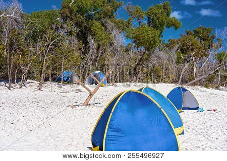 Blue Tourist Shade Tents On The White Silica Sand Of Whitehaven Beach In The Whitsunday Islands Of A