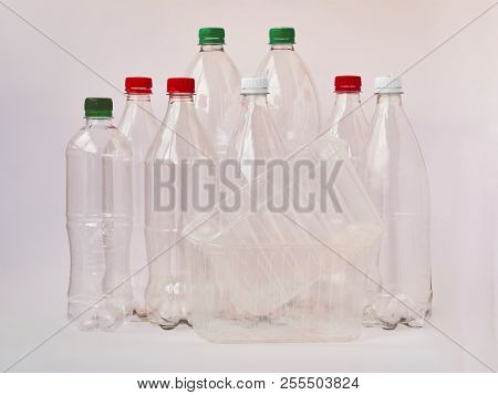 Empty Plastic Drinking Bottles Ready For Recycling. Environmental Protection Concept. Empty Colorful