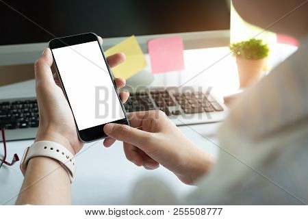Close Up Woman Hand Using A Smart Phone With Blank Screen At Modern Office. For Graphic Display Mont