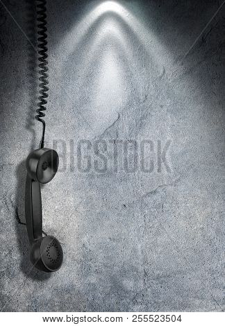 Black Old Handset With A Wire Hang Against Concrete Wall. 3d Rendering