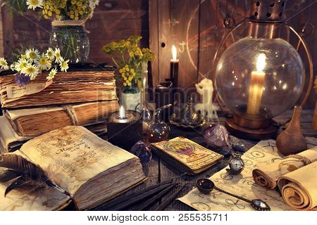 Still Life With Old-fashioned Lamp, Magic Witch Book, Tarot Cards And Old Papers. Mystic Background