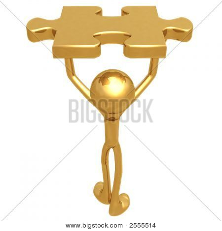 Holding The Golden Puzzle Piece