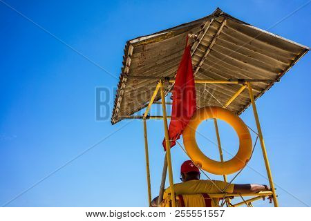 Swimming Rescue Lifeguard In Tower And Blue Sky