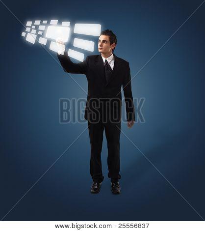 Business man pressing a touchscreen button, futuristic digital technology