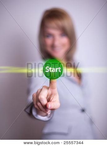 woman hand pressing START button, backround in bokeh