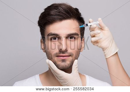 Filler forehead injection for male face in beauty clinic poster