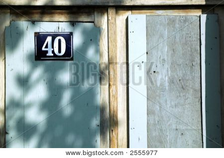Old wooden door with number 40. Close up view . poster