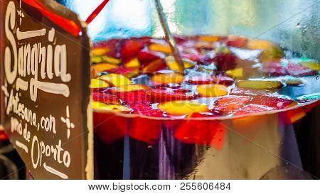 Madrid, Spain - August 27, 2017:  Artisan Port Wine Sangria Served At A Market Stand Inside The Hist