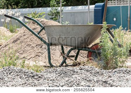Wheelbarrow Or Trolley For Construction In Site Building Area. Construction Industry Concept.