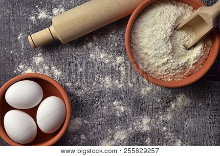 Baking Concept On Dark Background With Space For Text. Baking Preparation.  Top View . Utensils With