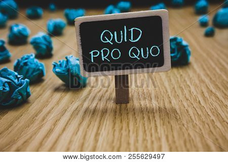 Writing note showing Quid Pro Quo. Business photo showcasing A favor or advantage granted or expected in return of something Blackboard crumpled papers several tries not satisfied wooden floor. poster