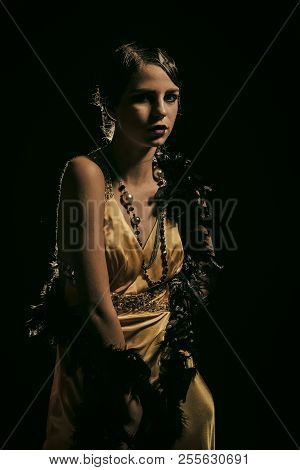 Beauty And Vintage Fashion. Girl In Fashionable Yellow Dress, Boa Fur. Woman With Stylish Retro Hair