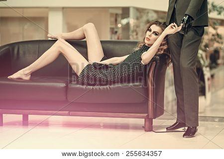 Girl Shopaholic Tired Shopping. Woman Shopper Relax On Sofa With Fashion Mannequin In Shop. Shop, Sh