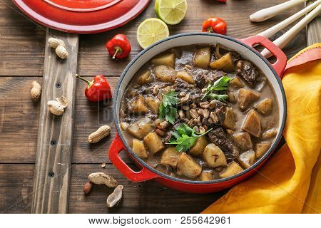 Massaman Curry With Beef And Potato On Wooden Background