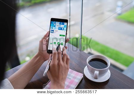 Chiang Mai, Thailand - August 18,2018: Woman Hands Holding Huawei Mobile Phone With Linkedin Applica