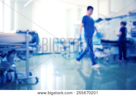 Working Medical Staff In The Bright Intensive Care Unit, Unfocused Background.