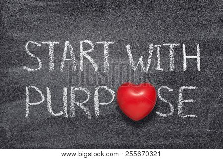 Start With Purpose Phrase Handwritten On Chalkboard With Red Heart Symbol Instead Of O