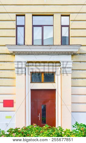 Generic Urban City Classic Style Building Exterior With Decorative Entrance. Old Town Big House With