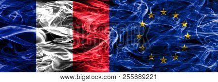 France Vs European Union Smoke Flags Placed Side By Side. Thick Colored Silky Smoke Flags Of France
