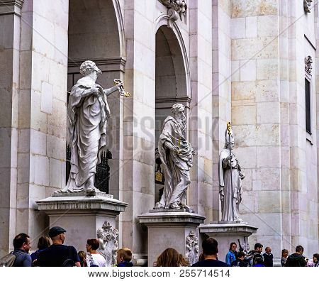 Salzburg, Austria- July 15, 2017: A Group Of Tourists Near Baroque Cathedral Of The Roman Catholic A