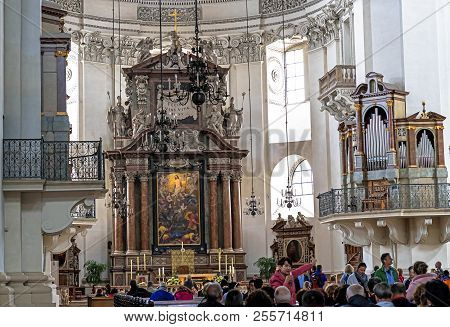 Salzburg, Austria- July 15, 2017: A Group Of Tourists In Baroque Cathedral Of The Roman Catholic Arc