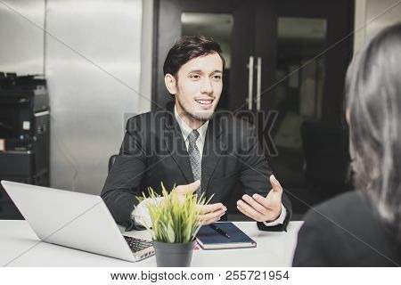 Smiled And Happy Manager Businessman Explaining, Introducing And Talking With Businesswomen About Ne
