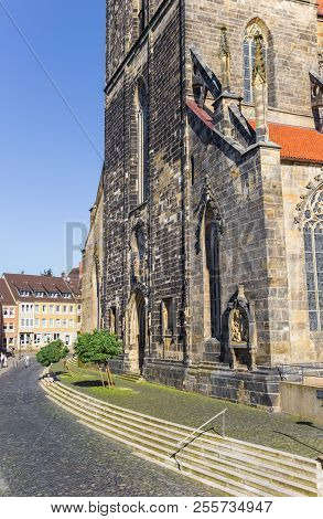 Hildesheim, Germany - October 15, 2017: Cobblestoned Street At The St. Andreas Church Of Hildesheim,