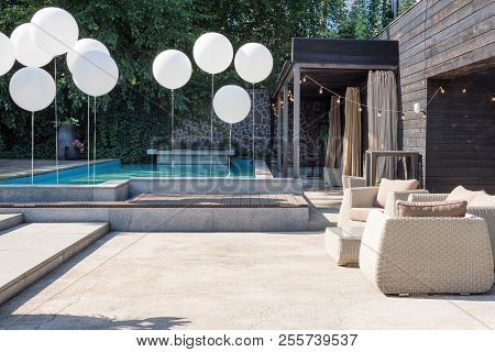 Wicker Armchairs And Table, Modern Garden Furniture. Cozy Space For Relax In The Garden With Pool.
