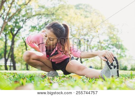 Healthy Young Asian Woman Exercising At Park. Fit Young Woman Doing Training Workout In Morning. You
