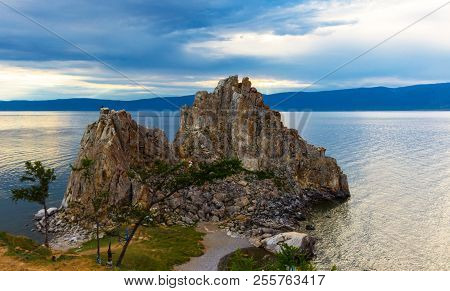 Awe Dusk Landscape With Shamanka Rock On Olkhon Island On Baikal Lake. Summer Vacation In The Heart